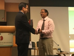 presenting a memento to dr. benjamin i chung durin